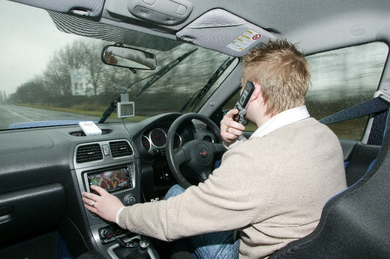 What if Mobile Phones Were Banned While Driving?